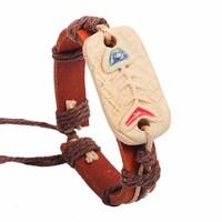 Vòng tay da handmade mặt dây hình xương cá - k4798