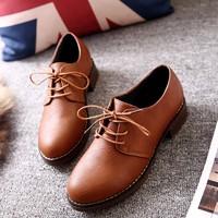 Giày Oxford da sần