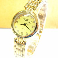 Đồng hồ Longine mặt vàng