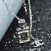 Dây chuyền titan chai Chanel đính hột dài trắng - trang sức inox
