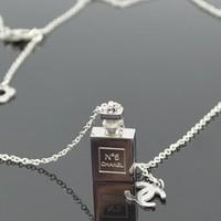 Dây chuyền titan chai Chanel trắng - trang sức inox