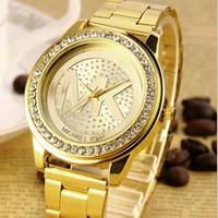 Đồng hồ MK kim loại mạ vàng sáng bóng lạ mắt