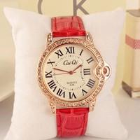 đồng hồ CAIQI đá lấp lánh màu hồng,có vòng nhỏ nhỏ bên hông