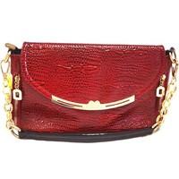 Túi xách cầm tay giả da cá sấu được thiết kế thời trang và sang trọng.