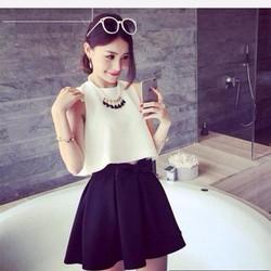 Set áo trắng croptop + chân váy đen xòe