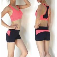 Bộ thể thao quần đùi - áo bra Nike