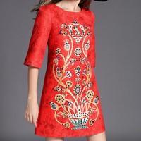 Đầm gấm hoạ tiết