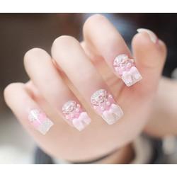 Mẫu nail trắng đính nơ hồng xinh
