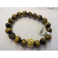 Vòng tay đá mắt hổ vàng 10 ly chạm rồng cải túi tiền bằng Vàng .