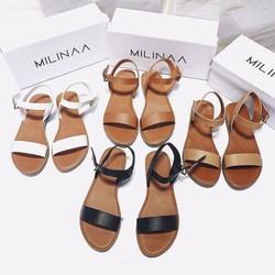 Sandal đế bệt với chất liệu da nữ