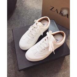 Giày thể thao trắng lót nâu bên trong