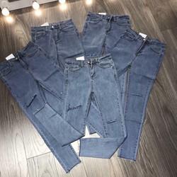 Quần jeans co dãn rách lai xẻ