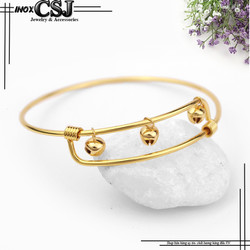 Vòng tay inox nữ thời trang 3 chuông màu vàng đẹp giá rẻ không đen
