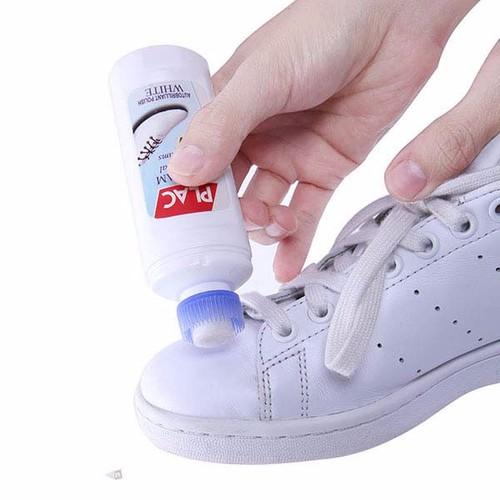 chai xịt trắng giày có bàn chải