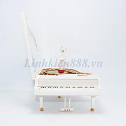 Đàn piano có nhạc và búp bê múa