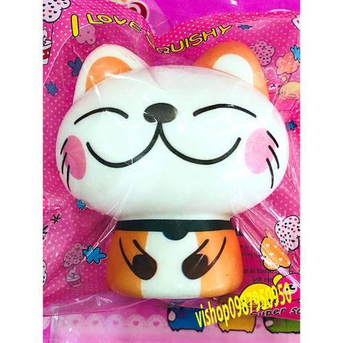 Squishy mèo thân cam nhắm 2 mắt thaolinh950
