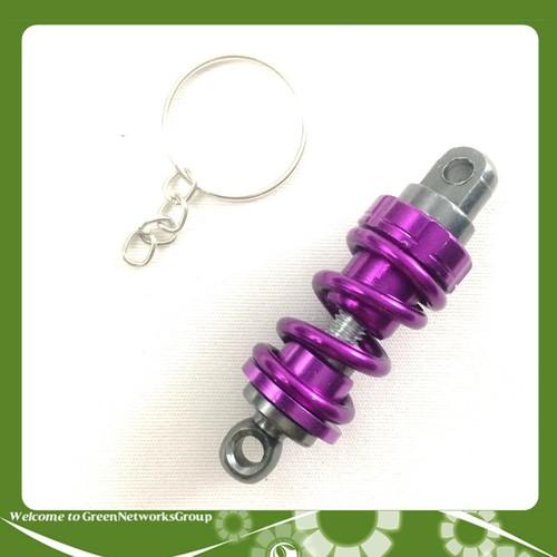 Móc khóa mô hình phuộc nhún GreenNetworks màu tím