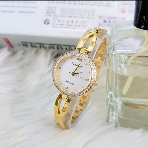 Đồng hồ lắc tay nữ