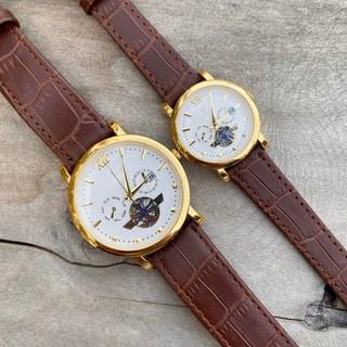 Đồng hồ cặp đôi nam nữ giá 1 đôi máy giả cơ viền vàng dây da có lịch tặng kèm 2 pin dự phòng ( có xem hàng ) - Ro9c thumbnail